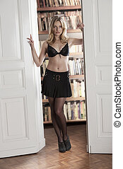 sexy girl standing in doorway - young sexy blond girl...