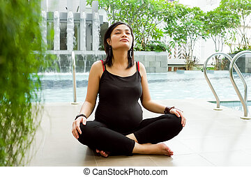 Asian pregnant woman exercise - Asian ethnic pregnant woman...