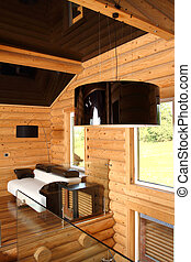 Spacious hall in the wooden house, executed in style...