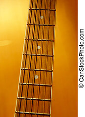 Guitar Frets - Fret board and strings on an acoustic guitar