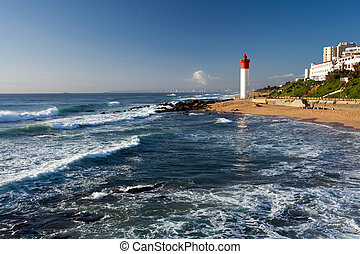 lighthouse in morning sunlight in Umhlanga beach, Durban,...