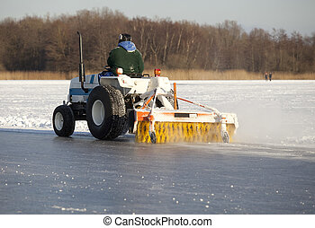Machine cleaning ice - Man on machine cleaning frozen lake...