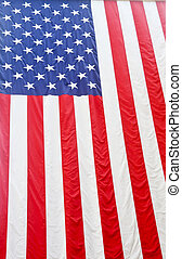 American Flag Hanging From Ceiling - A large American flag...