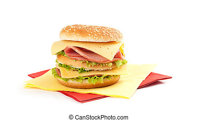 Big appetizing sandwich with lettuce, ham and cheese