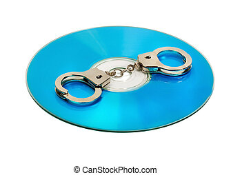 Pirate cd - Pair of handcuffs on a CD computer isolated on...