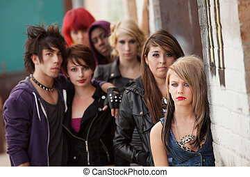 Serious Teen Punk Gang - Gang of young teen punks stare...