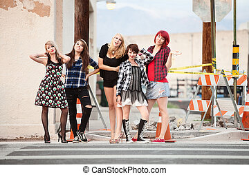 A group of attractive teen punk girls pose for the camera