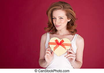 Smiling Woman With Valentines Gift