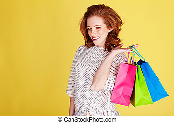 Happy Shopper With Colourful Bags - Happy smiling woman with...