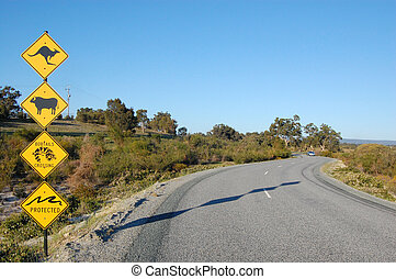 Australian road signs - Road sings in a park entrance,...
