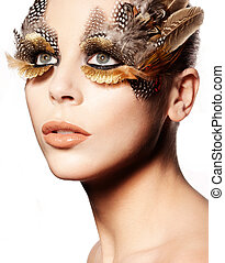 Creative Feathered Eye Makeup - Closeup portrait of a...