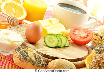 Breakfast including rolls, egg, cheese, coffee and orange juice
