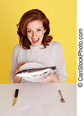 Woman Laughing At Fish - Humorous photo of a laughing...
