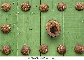 Oxide metal handle on old wood door