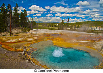 Boiling geyser - Beautiful cerulean geyser surrounded by...