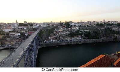Dom Luis I bridge in Porto, Portugal at sunset.