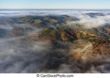 Aerial view of landscape with clouds