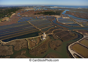 Aerial view of fish farms and salt marshes