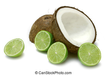 Coconut and Lime - Coconut half with lime halves, isolated...