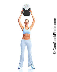 Fitness woman with a scales.