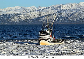 Classic fishing boat in an icy bay - Classic fishing boat...