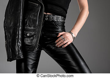 Black leather pants and jacket - Person wearing black...