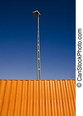 Cargo Container - Orange Cargo Container towards blue sky
