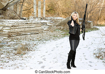 Nice young woman with a gun