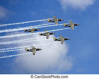 Air Force - Formation of Military Airplanes on blue sky