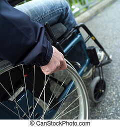 Wheel chair - Close up of a man in wheel chair