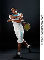 tennis player - Young tennis player with racket playing...