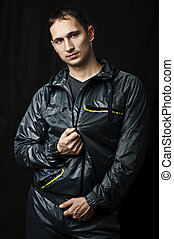 Portrait of young sexy man in sportswear
