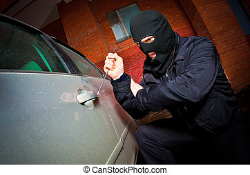 robber and the thief in a mask hijacks the car - robber and...