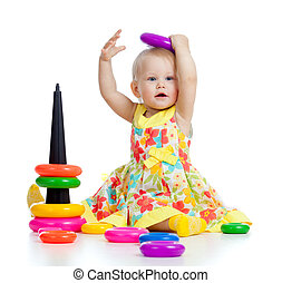 funny baby playing with color developmental toy