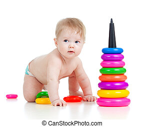 baby playing with color developmental toy