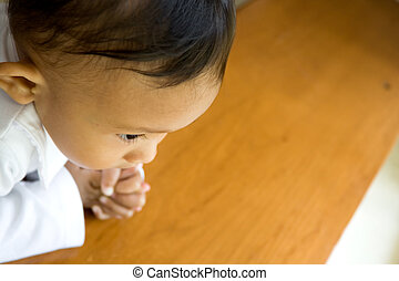 ethnic child praying - cute asian ethnic child praying