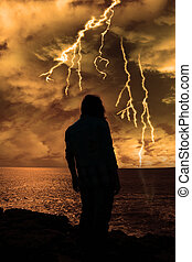 woman looks out at storm as if life is just to much - a lone...