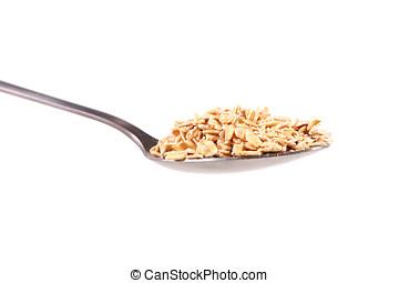 rolled oats in spoon