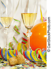 Two glasses of champagne and paper streamer