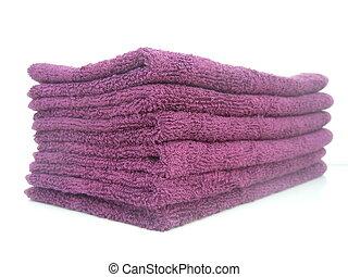 folded towels - six folded purple towels