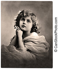 Old photo - Vintage portrait of a young girl. The shot was...