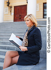 Young businesswoman with a notebook