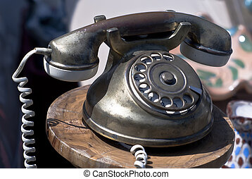 Vintage phone - Old-fashioned phone isolated on a blurred...