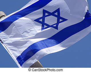 Flag of Israel blowing in the wind - The blue and white...