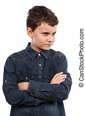 Angry boy with arms folded - Closeup portrait of an angry...