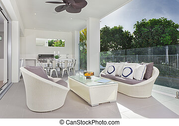 Modern under cover patio - Luxurious undercover patio with...