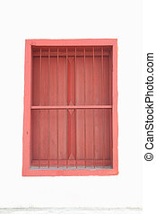 Red window on white wall.