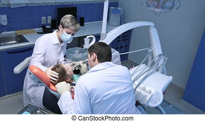 Dentist at work - Dentist working with a little patient,...