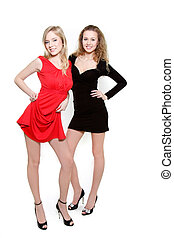 studio shot of two young beautiful women