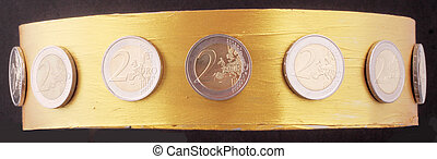 crown - A golden crown with 2 Euro coins